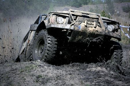 Extreme off-road. The vehicle jumping and splashing out the mud