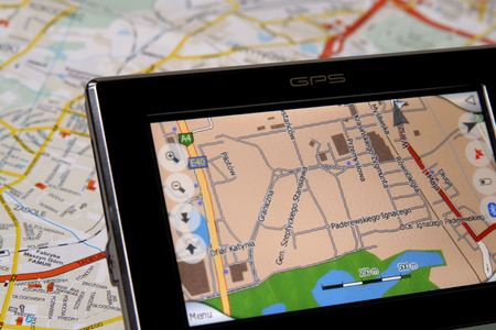 turism: A GPS mobile (navigation device) and old traditional map