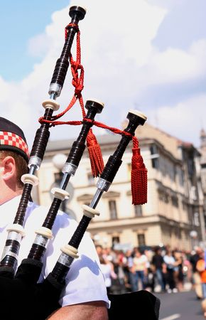 scot: A man-musican with black Scottish pipes