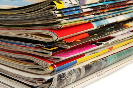 book reviews: Stack of colorful magazines on light background