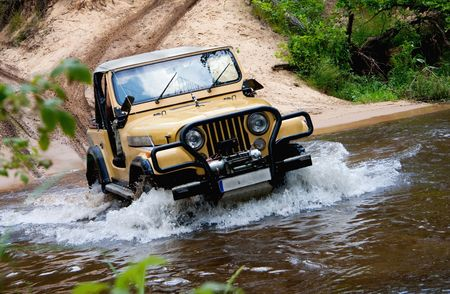 offroad: Off-road. The vehicle splashing water from the river Stock Photo