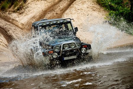 Off-road. The vehicle splashing water from the river photo