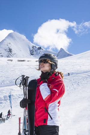 breath taking: Sportswoman taking a deep breath after skiing Stock Photo