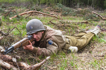 firing: American World War II infantry soldier prepering for shooting