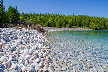 Crystal water and white stony coastline at Bruce Peninsula National Park Ontario Canada