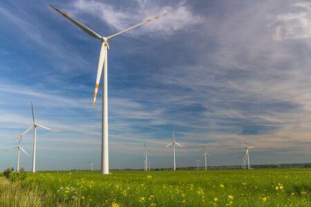 Eco power. Wind farm Renewable energy resources. Wind turbine field in Poland