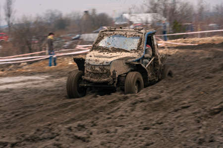 Dirty 4x4 vehicle starting in a off road competition. Dynamic shot of car on in the off road circuit race