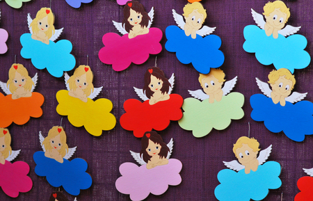 Many small wooden smiling angels photo