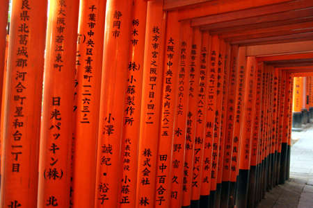 Fushimi Inari in Kyoto, Japan - Close up of the Red gates (Torii) lining the path up the hill