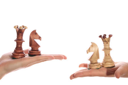 CHESS PIECES ON THE PALMS ISOLATED ON WHITE BACKGROUN Stock Photo - 10056124