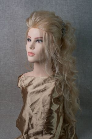 Head of a dummy for styling hair blonde