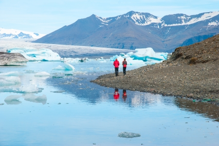 Couple is walking around Jokulsarlon, Iceland  photo