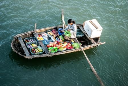 ferrying: Boat seller in Ha Long bay, Vietnam