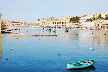 skiff: Single boat in bay, Valetta, Malta
