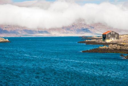 House near calm bay of Djupivogur, fishing town in Iceland  photo