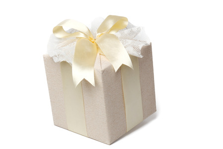 beautifully wrapped: Beautifully wrapped gift. Beautiful gift box with packing beige paper, gold ribbon and lace.