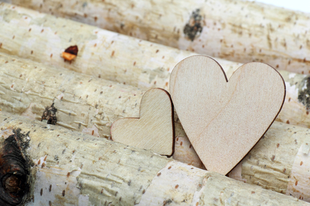 crack willow: White heart and wooden  background. Stock Photo