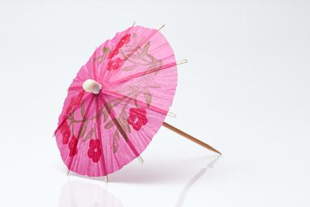cocktail umbrella: Cocktail umbrella on a white background.