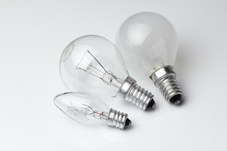 Electric lamp bulbs on a white background. Stock Photo