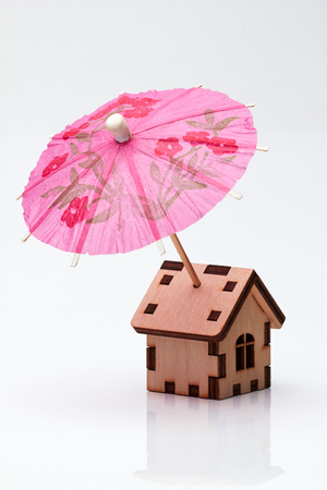 cocktail umbrella: Wooden house and cocktail umbrella.