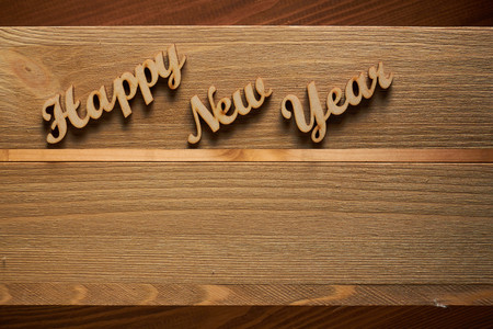 letterpress type: Happy New Year! - A phrase with wooden letters on a wooden background. Stock Photo