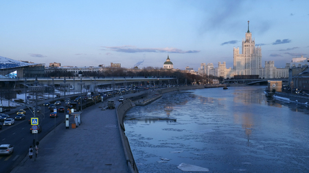 Floating bridge of Zaryadye park and high-rise building on Moskvoretskaya Embankment of Moskva River in Moscow city, Russia.
