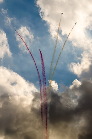 Airplanes on airshow. Aerobatic team performs flight at air show
