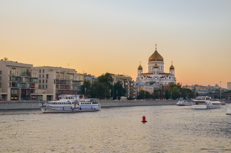 The Cathedral of Christ the Saviour with the sailboat drifting on the river