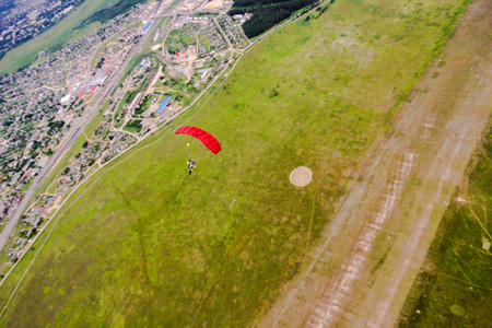 parachutist in the sky, view from above to earth Stock Photo