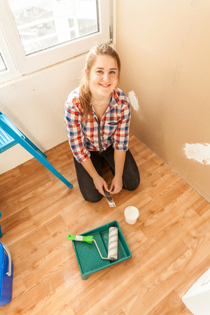 Young smiling woman doing renovation on balcony photo