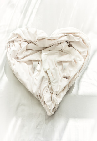 bed sheet in shape of heart photo