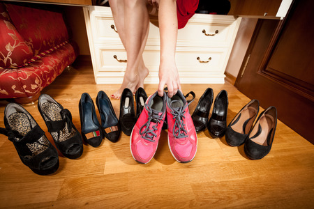 sexual selection: Closeup photo of female picking sneakers rather than black shoes