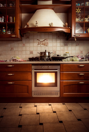 oven: Interior photo of country style kitchen with hot oven Stock Photo