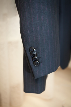 Closeup photo of male jacket sleeve with buttons Stock Photo