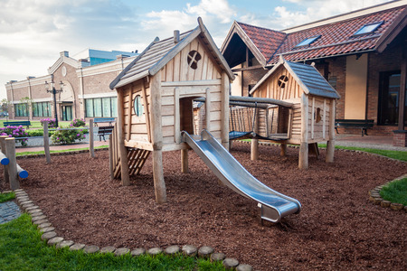 Outdoor shot of big wooden playground at shopping mall Фото со стока
