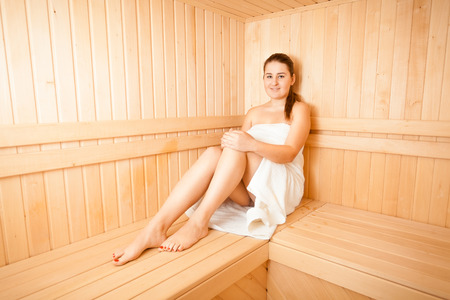 Beautiful slim woman steaming at sauna