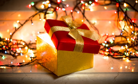 Closeup photo of open gift box with light coming out of it Standard-Bild