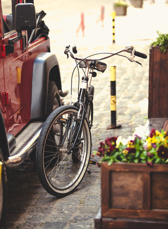 hitched: Toned photo of vintage bike hitched to car with chain