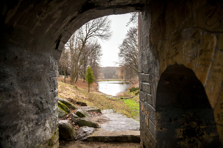 battleground: View through old tunnel on lake and park