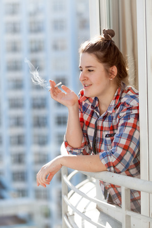 unhealthy thoughts: Portrait of hipster girl smoking cigarette Stock Photo