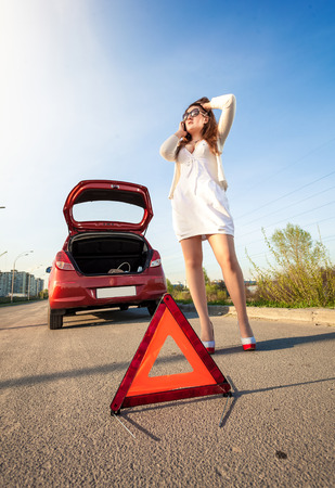 Sexy woman calling mechanic after car breakdown photo