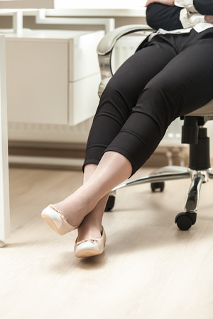 office shoes: Closeup photo of businesswoman wearing comfortable ballet flats Stock Photo
