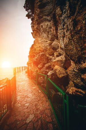 handrails: Beautiful view of path with handrails in high mountains at sunset
