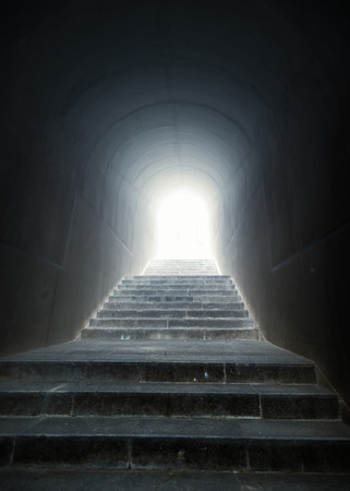 Conceptual shot of staircase in the tunnel with light at the end