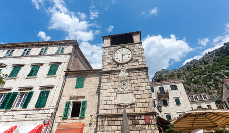 High stone tower clock in city of Kotor, Montenegro photo