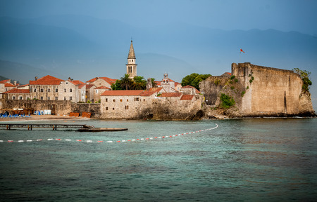 Beautiful view of ancient seaside town with high stone walls photo
