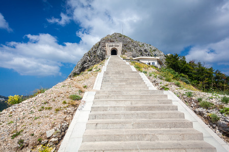 petrovich: Beautiful landscape of stairs and tunnel in mountain of Lovcen Stock Photo