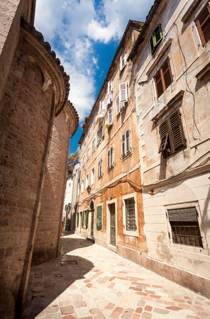 Beautiful view of old narrow street at city of Kotor, Montenegro photo