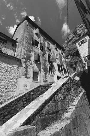 narrow: Black and white photo of big stairway at old city with narrow streets