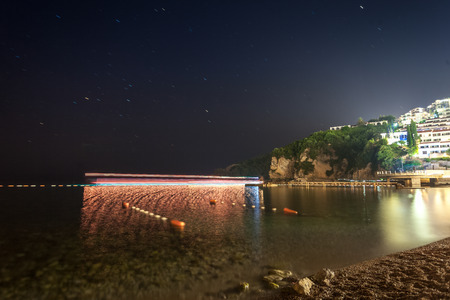 Beautiful night landscape of floating ships in bay of Budva, Montenegro photo